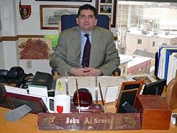 Secretary John Scocos