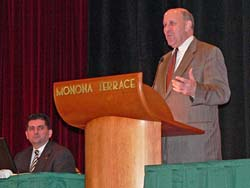 Governor Jim Doyle speaks, Secretary John Scocos looks on (Photo: Jackie Johnson)
