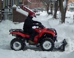 An atv with plow blade cleans up near the UW Madison campus. IMAGE: Bob Hague