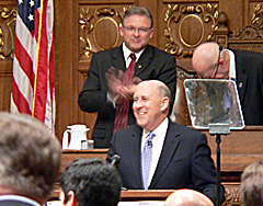 Assembly Speaker Mike Sheridan standing behind Governor Jim Doyle (Photo: Jackie Johnson)