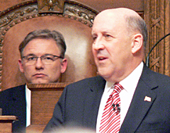 Assembly Speaker Mike Sheridan looks over Governor Jim Doyle's shoulder during the budget address (Photo: Jackie Johnson).
