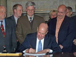 Gov. Doyle signs an economic recovery bill.