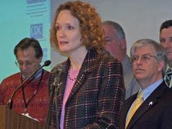 DHS Sec. Karen Timberlake briefs reporters.