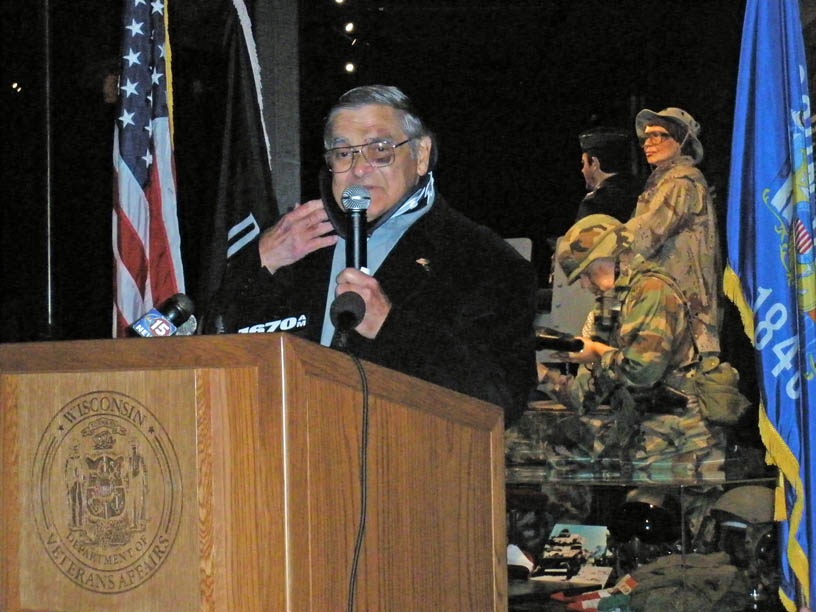 Don Heiliger speaks at a POW-MIA Recognition Day ceremony. (He's wearing a neck brace and has stitches near his eye after recently falling into his fireplace.)