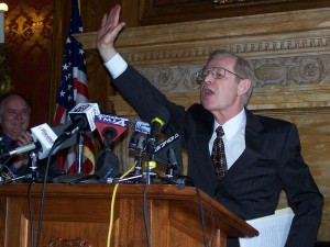 Justice David Prosser waves to supporters.