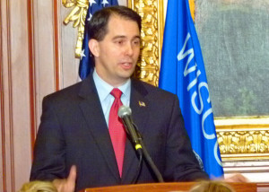 Governor Walker hands out financial literacy awards in his conference room before answering reporters questions about the concluded John Doe investigation.