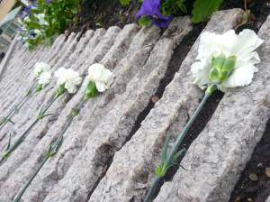 Five carnations laid on the Law Enforcement Memorial in honor of the five fallen officers