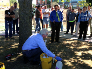 Arborjet arborist Jeff Palmer perform an injection treatment on an ash tree.