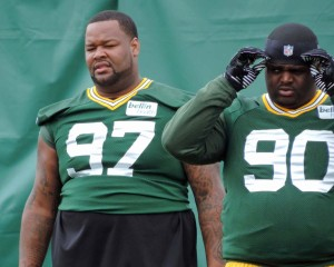 Johnny Jolly (left) getting ready for Sunday