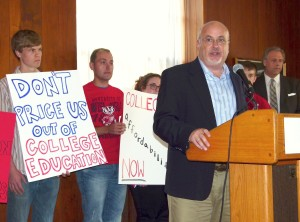 Congressman Mark Pocan explains new legislation. Scot Ross looks on.