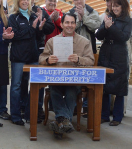 Governor Walker signs tax cut bill into law (PHOTO: Courtesy of governor's offic)