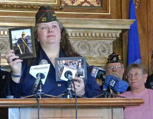 Renee Simpson, State Commander of the Wisconsin Veterans of Foreign Wars, shares her emotional story. She's part of a family of Army veterans. Simpson says her entire family has been exposed to asbestos. (PHOTO: Jackie Johnson)