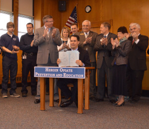 Nygren watches as Governor Walker signs heroin bills into law (PHOTO: Governor's office)