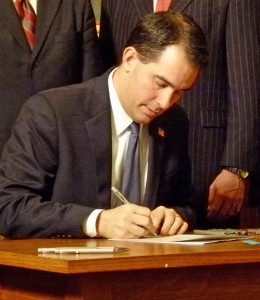 Governor Walker signs legislation (PHOTO Jackie Johnson file photo)