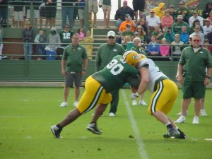 B.J. Raji rushes against J.C. Tretter in Training Camp practice.