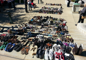 Empty shoes line the steps outside the state Capitol building in Madison. (Photo: Andrew Beckett)