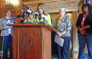 Surrounded by advocates, State Representative Chris Taylor speaks about pay equity for women. (PHOTO: Jackie Johnson)