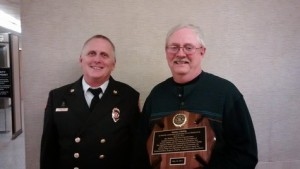 Stevens Point Fire Chief Robert Finn and UPS Driver James Phillips, who received the Meritorious Service Award from the City of Stevens Point. (PHOTO: Larry Lee © 2015 Midwest Communications)