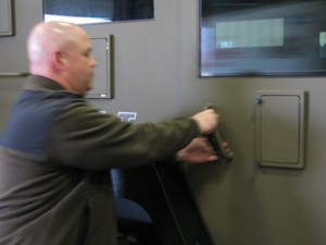 Marathon County Chief Deputy Chad Billeb unlocking the SWAT team armored vehicle (PHOTO: Larry Lee, WSAU)