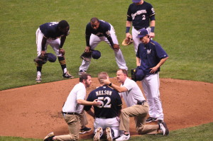 Jimmy Nelson tended to by Brewers training staff, after being hit in the head by a line drive.
