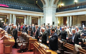 Members of the Assembly honor the victims of terrorist attacks in France. (Photo: Andrew Beckett)