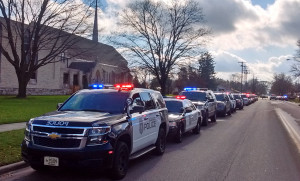 Police cars line up in a procession honoring Officer Copeland. (Photo: WCLO)