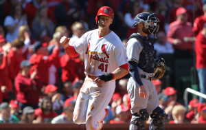St. Louis Cardinals Jeremy Hazelbaker pumps his fist as he crosses home plate on a double by Matt Holliday in the first inning against the Brewers. Photo by Bill Greenblatt/UPI
