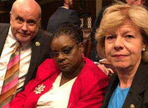 U.S. Representative Mark Pocan (D-WI) and Gwen Moore (D-WI), along with U.S. Sen. Tammy Baldwin (D-WI) on the floor of the U.S. House.