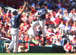 Milwaukee Brewers Ryan Braun celebrates his 27th HR of the season with third base coach Ed Sedar after hitting a solo home run in the ninth inning against the St. Louis Cardinals - Photo by Bill Greenblatt/UPI