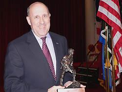 Governor Doyle holds Iron Mike award (Photo: Jackie Johnson)