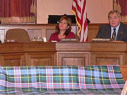 Lothian shows sample cloth at committee hearing (Photo: Jackie Johnson)