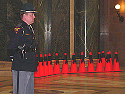 Work zone awareness week at Wisconsin state capital. Orange cones with black ribbons placed throughout the capital rotunda represent 132 lives lost in work zone crashes since 1997. (Photo: Jackie Johnson)