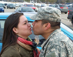 Sgt. Dustin Constino of Milwaukee kisses his girlfriend, Serena Cisneros of Milwaukee, outside Tuesday's sendoff ceromony.