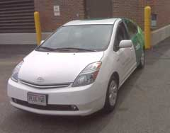 MG&E's all electric Prius conversion plugged in to charger