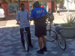 Bicylcist ticketed in Madison. IMAGE: Bob Hague