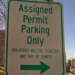 Sign implies ticket and tow zone on Square