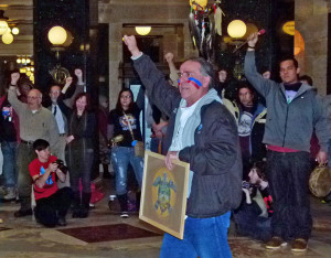 Marvin Defoe, other members of Red Cliff Band of Lake Superior Chippewa, and onlookers voice opposition to mining bill.