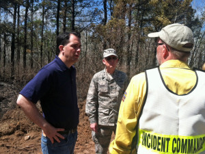 Gov. Scott Walker meets with crews working to contain a massive wildfire in northern Wisconsin.