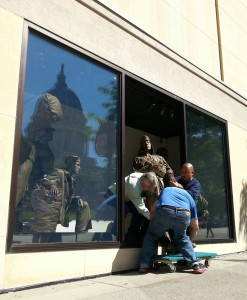 "Bronze figures are removed to make way for  ""updated"" window displays at the museum. ""We've had some issues with lighting in there; we're gonna fix the lighting."" (PHOTO: Jackie Johnson)"