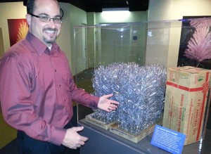 Curator Joe Kapler describes how the packaging has changed to make the box smaller and easier to ship, carry, and store.