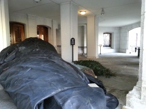 Balsam fir being outside Capitol building protected in tarp.