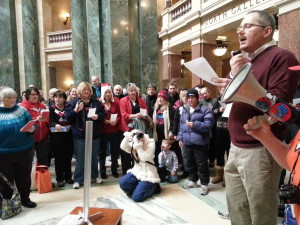 Festivus organizer Greg Gordon speaks to the crowd at the Capitol