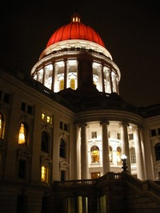 Wisconsin State Capitol building illuminated in red. (FILE PHOTO: Jackie Johnson)