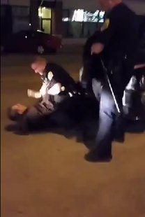 Still  from arrest video. (Photo from: YouTube).