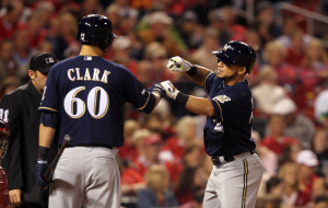 Gerardo Parra is greeted at home plate by Matt Clark after 4th inning home run. - UPI/Bill Greenblatt