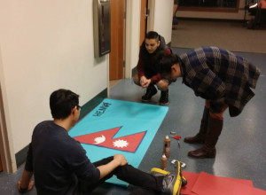 Lawrence University students work on a poster to promote Nepal relief efforts. (Photo: Nepal Relief Facebook page)