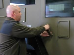 Marathon County Chief Deputy Chad Billeb unlocking the SWAT team armored vehicle (PHOTO: Larry Lee, WSAU)