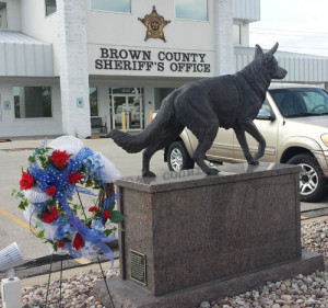 A memorial wreath for Wix placed outside the Brown Co. Sheriff's office (Photo: WHBY)