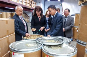 Paul Hsu, Lieutenant Governor Rebecca Kleefisch and Will Hsu inspect a delivery of ginseng during a visit to Hsu's Ginseng in Wausau (Photo: Raymond Neupert)