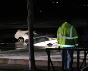 Cars partially submerged in Lake Geneva.